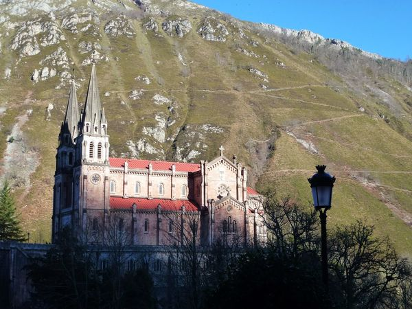 Church And Rock SPIRITUAL HEALING Architecture Beauty In Nature Building Exterior Built Structure Catholic Faith Church Behind The Mountain Church In The Sun Day Mountain Nature No People Outdoors Sky Tree