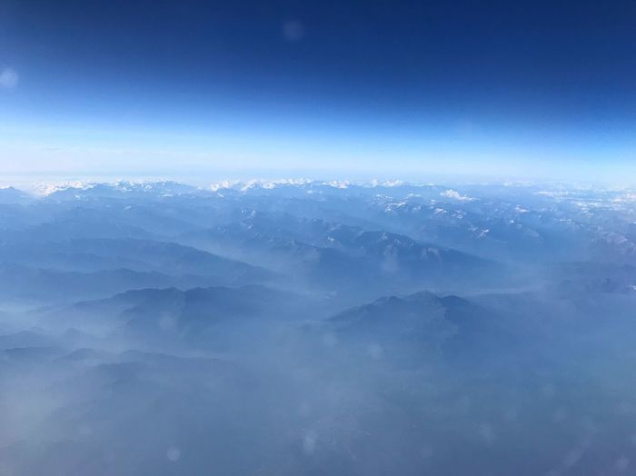 Snow Capped Mountains Mountain Range Mountains Sky Blue Cloud - Sky Beauty In Nature Nature Scenics - Nature Aerial View Meteorology Airplane Flying Day Outdoors Backgrounds Environment Tranquil Scene Copy Space Idyllic Tranquility No People Cloudscape