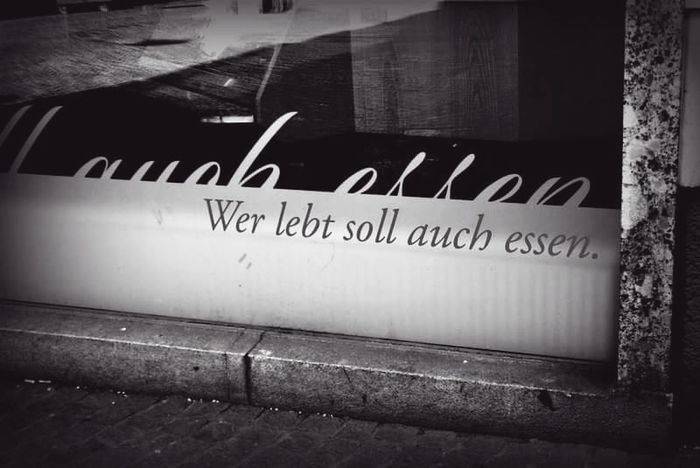 Who lives shall eat. Text No People Day Black & White Eating Disorders Food German Language Blackandwhite Photography Reflection Streets Be. Ready. Black And White Friday