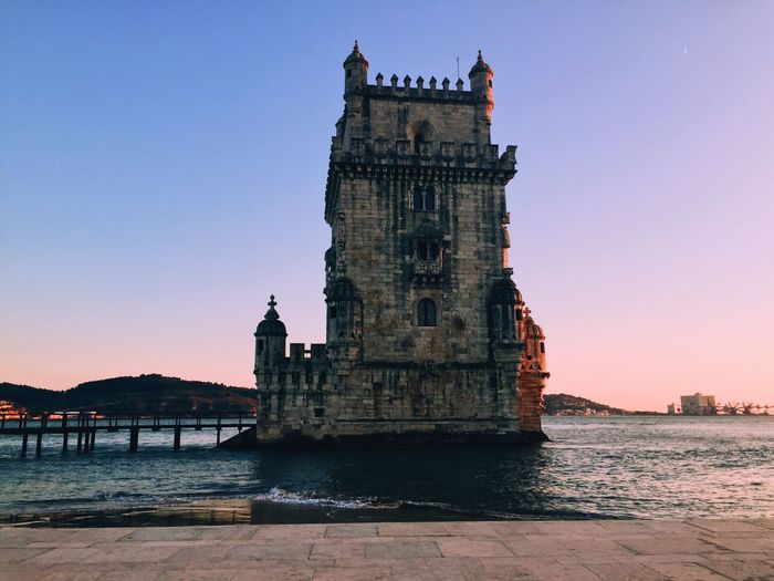 Towering Bay Sunset Lisbon Portugal Belém Architecture Sky Water Built Structure Building Exterior Clear Sky Travel Destinations City The Past History Travel Tourism My Best Travel Photo