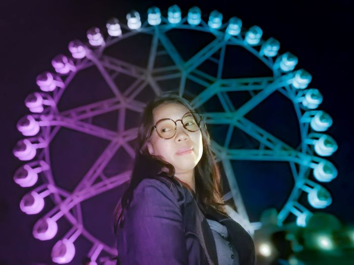 Portrait of a smiling woman in amusement park