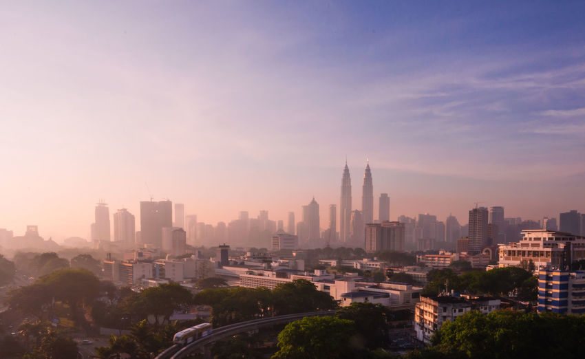 Aerial view of kuala lumpur city. Architecture Building Exterior Business Finance And Industry City City Life Cityscape Day Downtown District Drone  High Angle View Internet Marketing Klcc Lifestyle Modern Monorail  Networking No People Outdoors Popular Places Sky Skyscraper Sunrise City Sunset Travel Destinations Urban Skyline