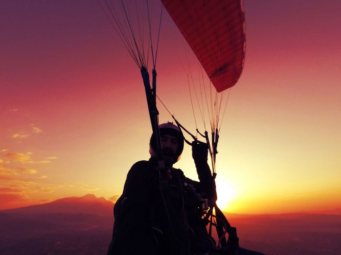 Man paragliding against sky