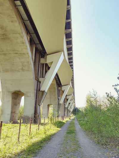 Bridge - Man Made Structure Architecture Sky Built Structure Grass Underneath Railway Bridge Empty Road Viaduct Country Road Engineering The Way Forward Overpass Under Below vanishing point
