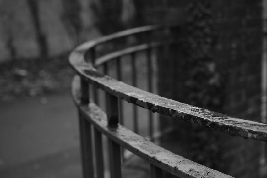 Nice bit of old iron railing leading round an unknown corner Monochrome Fence Blackandwhitephotography Pathway Railing _ Collection Neglected