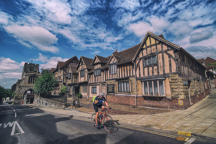 Be the reason someone smiles today. It can start a wave of positive reactions. Architecture Architecture_collection City Life Cityscape Great Britain Sky And Clouds Summer Road Tripping TOWNSCAPE The Street Photographer - 2018 EyeEm Awards United Kingdom Warwick Architecture Bicycle Bike Biker City England Europe Lord Leycester Hospital Mode Of Transport Mode Of Transportation One Person Town Warwickshire Wide Angle