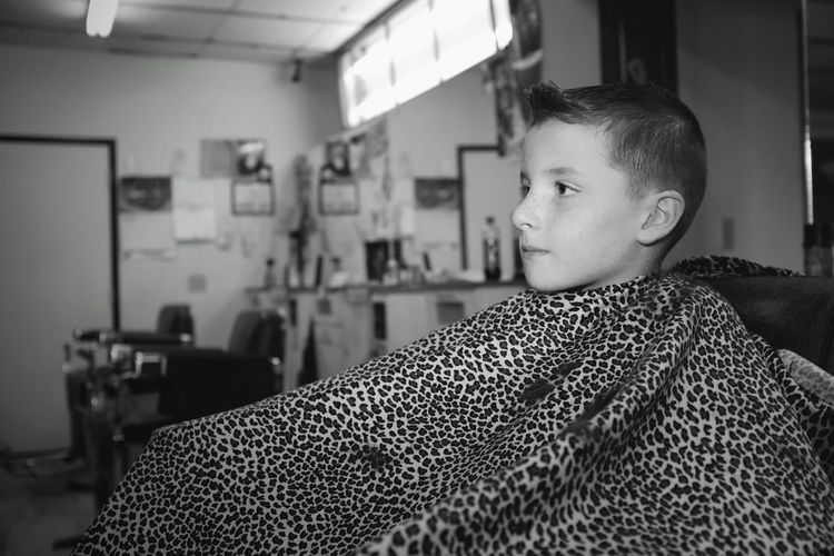 Visual Journal August 2017 Southeast Nebraska B&W Portrait Barbershop Camera Work Everyday Lives EyeEm Best Shots EyeEm Gallery Fresh Haircut Getty Images Kids Of EyeEm Photo Essay Rural America Storytelling Visual Journal Boy Boys Childhood Day Elementary Age Eye For Photography Flash Photography Focus On Foreground Fujifilm_xseries Haircut Indoors  Monochrome One Person People Photo Diary Real People Schwarzweiß Sitting Small Town Stories The Portraitist - 2018 EyeEm Awards