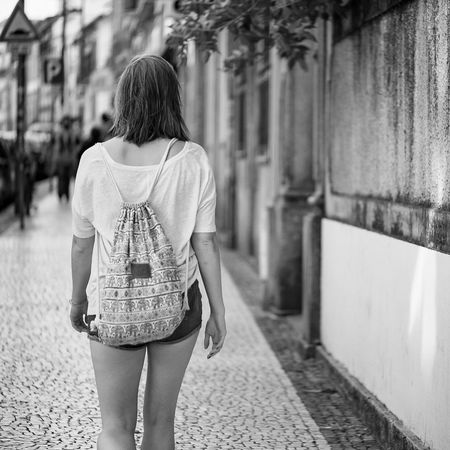 Monochrome Photography Rear View Standing Lifestyles Focus On Foreground Casual Clothing Leisure Activity Person Outdoors Daylight Rear View Standing Lifestyles Focus On Foreground Casual Clothing Leisure Activity Person Outdoors Architectural Column Woman