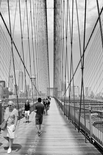 EyeEm Selects EyeEm Selects Bridge - Man Made Structure Suspension Bridge Sky Outdoors City Architecture Built Structure Lifestyles People Brooklyn Bridge  NYC Photography Hanging Out Taking Pictures Enjoying The Moment Day People Watching Brooklyn Bridge  People Watching NYC Walking The Brooklyn Bridge