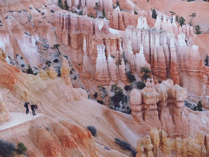 High angle view of men photographing at bryce canyon national park