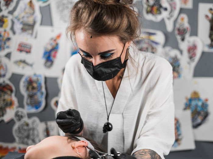Piercing master, portrait Indoors  Lifestyles One Person Young Adult Real People Front View Portrait Casual Clothing Glasses Young Men Creativity Focus On Foreground Leisure Activity Holding Adult Fashion Waist Up Young Women Hairstyle