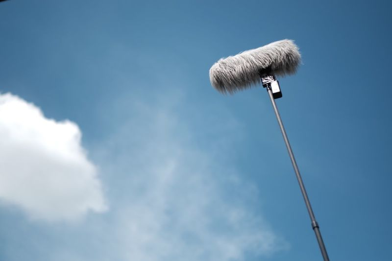 Low angle view of microphone against sky