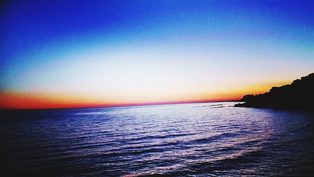Sea Sunset Scenics Beauty In Nature Nature Multi Colored Horizon Over Water Tranquility Outdoors Sky Water Tranquil Scene No People Beach Travel Destinations Blue Rippled Clear Sky Day Lost In The Landscape