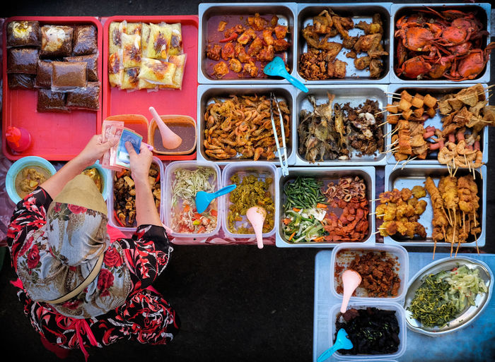 Directly Above Shot Of Woman Standing At Food Stall