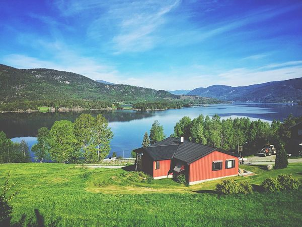 Mountain Water Tranquil Scene Lake Scenics Tranquility Day Sky Built Structure Beauty In Nature Grass No People Landscape Nature Green Color Architecture Outdoors Tree Norway🇳🇴 Norway Travel Destinations The Great Outdoors - 2017 EyeEm Awards