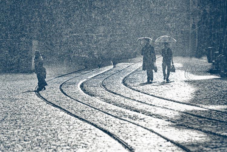 People walking on street during monsoon