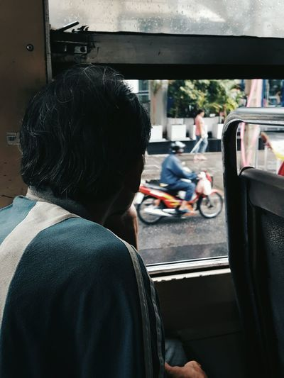 Humans of Bangkok Bus Human Bokeh Real People Men People Motorcycle Hipster One Man Only Day Outdoors One Person Social Issues Bangkok Thailand Rain Mood First Eyeem Photo
