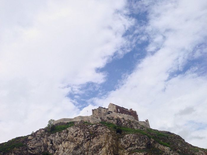 Low-angle view of castle on hill