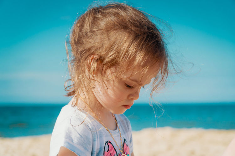 Summer Child Girl Kid Sea Beach Water Sky Childhood Land Headshot Leisure Activity Innocence Real People One Person Nature Horizon Over Water Sand Cute Looking Day Hair Focus On Foreground Outdoors Contemplation Hairstyle