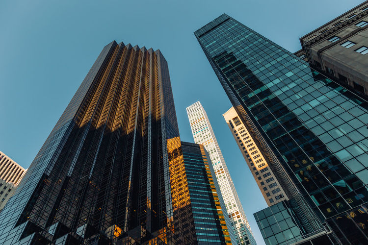 Low angle view of modern buildings against clear sky in city