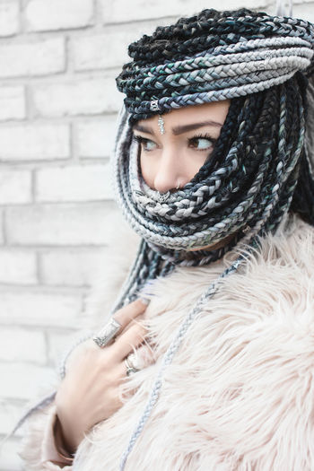Woman with very long braids wrapped around her face as a hijab Adult Beautiful Woman Clothing Cold Temperature Front View Fur Hair Hairstyle Headshot Human Face Lifestyles One Person Portrait Real People Scarf Warm Clothing Winter Women Young Adult Young Women