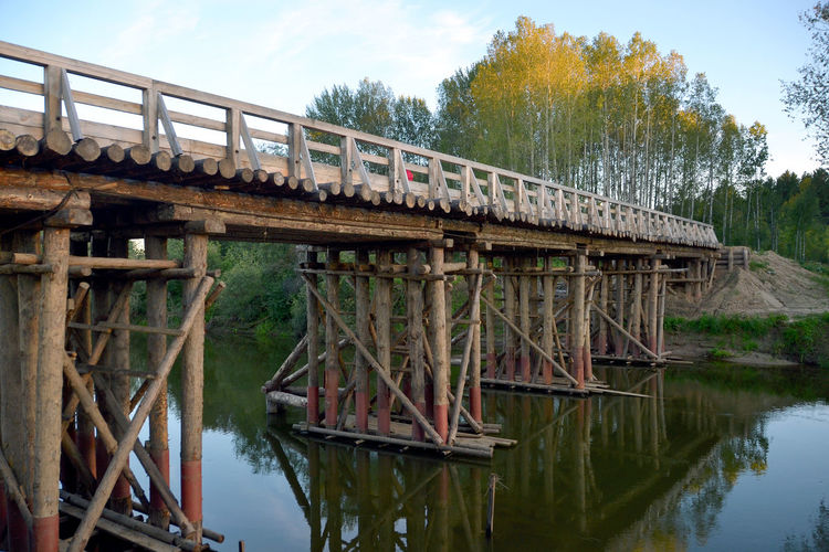Fishing. Tomsk region, Siberia, Russia. Bridge for timber-trucks. Beauty In Nature Bridge Bridge For Timber-trucks. Built Structure Engineering No People Outdoors Reflection River Russia Siberia Sky Tomsk Region Tomsk Region Tranquil Scene Tranquility Water EyeEm Selects
