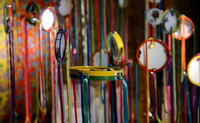 Tambourines hanging with multi colored ribbons