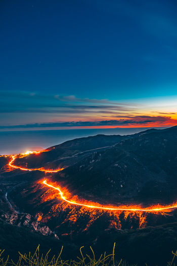 Malibu Canyon Road Sky Beauty In Nature Scenics - Nature Mountain Nature No People Night Orange Color Volcano Land Environment Cloud - Sky Non-urban Scene Tranquil Scene Outdoors Geology Glowing Blue Lava Landscape Power In Nature Astronomy Flowing My Best Photo