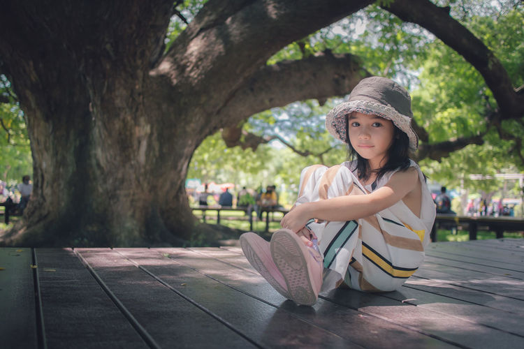 Portrait of a girl sitting on tree