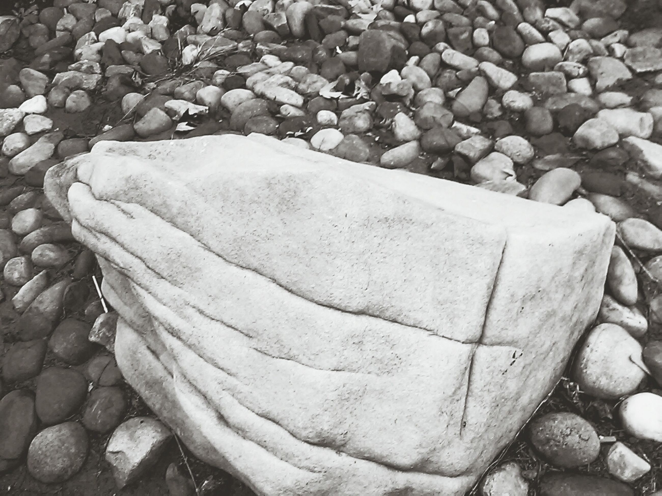 stone - object, rock - object, pebble, high angle view, textured, nature, beach, stone, stack, rock, day, outdoors, tranquility, close-up, sand, no people, abundance, large group of objects, shore, rough