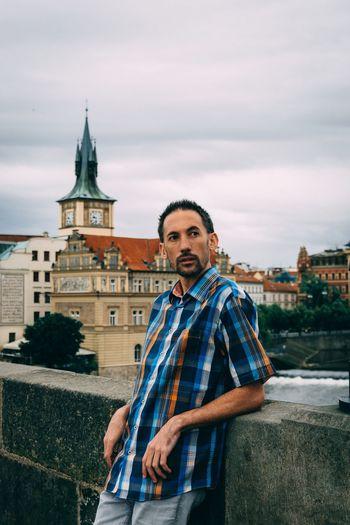 Portrait of  a man standing in a bridge