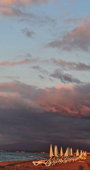 Sand & Sea Rest Umbrellas Sunrise Holidays ☀ Rainymood Sunnymood 2face Love ♥ Turkey Seascape Season  Sea View Sealife Calm Water Clouds And Sky Holiday Memories Deniz Gökyüzünde Günbatımı Tatilkafasi şezlong Kumsal Beachphotography