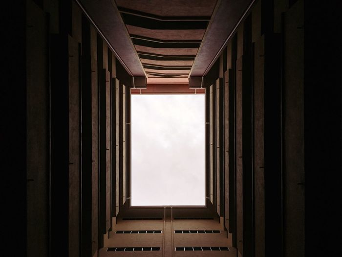 EyeEm Selects Architecture Built Structure Building Indoors  No People Window Sky Day Directly Below Low Angle View Cloud - Sky Nature Pattern Corridor Arcade City Wall - Building Feature Skyscraper