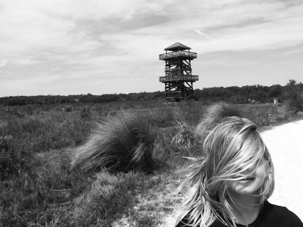 In The Forest Lookout Tower In The Distance Wind Swept Hair In Face Little Girl On A Hike Being Silly Being Adventurous