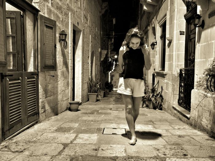 Full Length One Person Lifestyles Only Women Adults Only Real People Building Exterior Adult Outdoors Built_Structure Day Women One Woman Only Architecture People Young Adult Young Women Togetherness Friendship Maltaphotography Malta Tranquility Architecture Let's Go. Together.