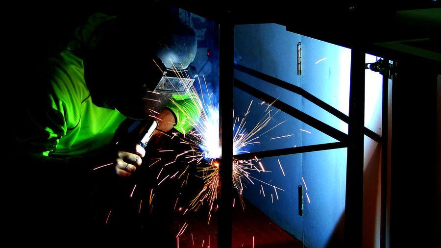 View of man welding