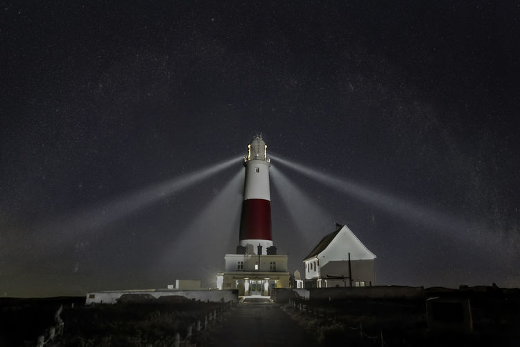 Lighthouse Against Sky At Night