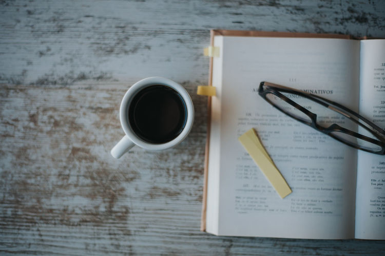 Coffee Coffee Time Food And Drink Table Black Coffee Coffee Break Studying Reading Directly Above Publication Coffee Cup Crockery Indoors  High Angle View Mug Still Life Book No People Cup Refreshment Paper Glasses Education Learning Languages