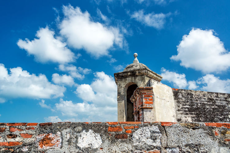 Blue sky behind a wall of San Felipe de Barajas castle in Cartagena, Colombia Architecture Architecture_collection Balconies Balcony Bolivar Brick Bricks Caribbean Cartagena Cartagena De Indias Cityscape Colombia Colombian  Colonial Colonial Architecture Historic Landmark Old Restored Sky South America Unesco UNESCO World Heritage Site Urban Wall