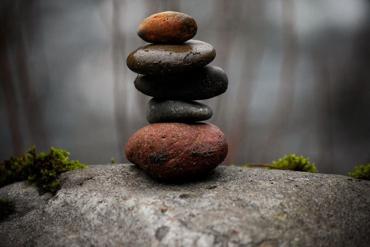 Close-Up Of Stacked Pebbles On Rock