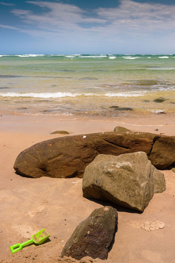 Lonely shovel on the beach Australia Beach Caloundra Horizon Over Water Leisure Activity Nature Outdoors Remote Rock Rock - Object Rock Formation Sand Sea Shore Shovel Stone Toy Tranquility Travel Traveling Water