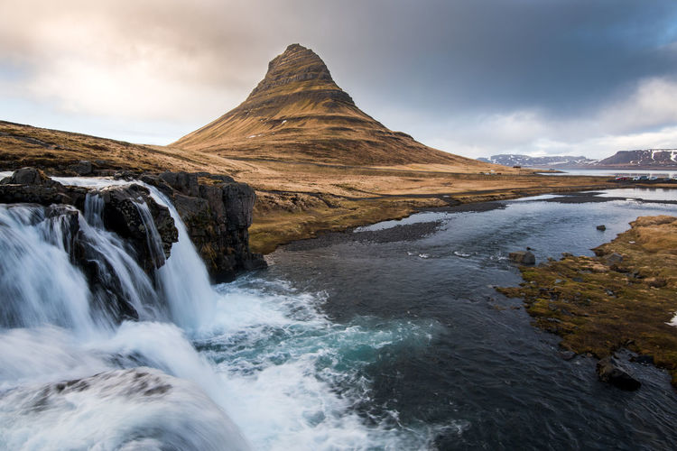 The kirkjufell mountain and the kirkjufellfoss waterfall at grundarfjordur in iceland