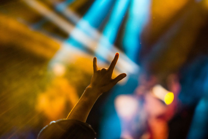 Close-up Enjoyment Excitement Fun Gesturing Horn Sign Human Body Part Human Finger Human Hand Illuminated Indoors  Leisure Activity Lifestyles Music Night Nightlife One Person Performance Popular Music Concert Real People Rock Music Selective Focus Youth Culture