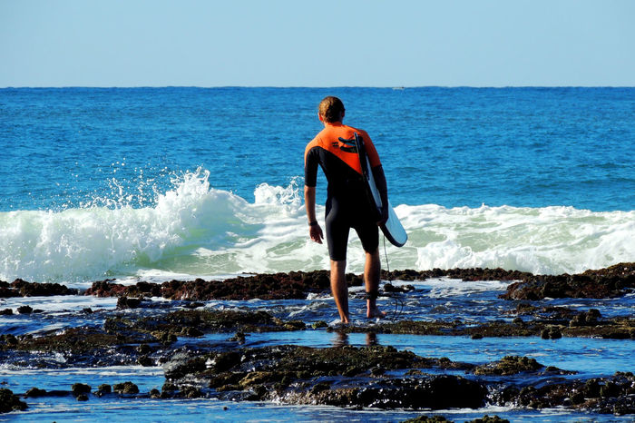 Young male surfer checking surf conditions in Australia. Australia Australian Surfer Going For A Surf Ocean Ocean Waves Reef Rock Sea Shorebreak Surf Surf Australia Surf Check Surf Photography Surf's Up Surfboard Surfbreaker Surfer Surfer Dude Surferphotos Surfers Surfing Waves Waves And Rocks