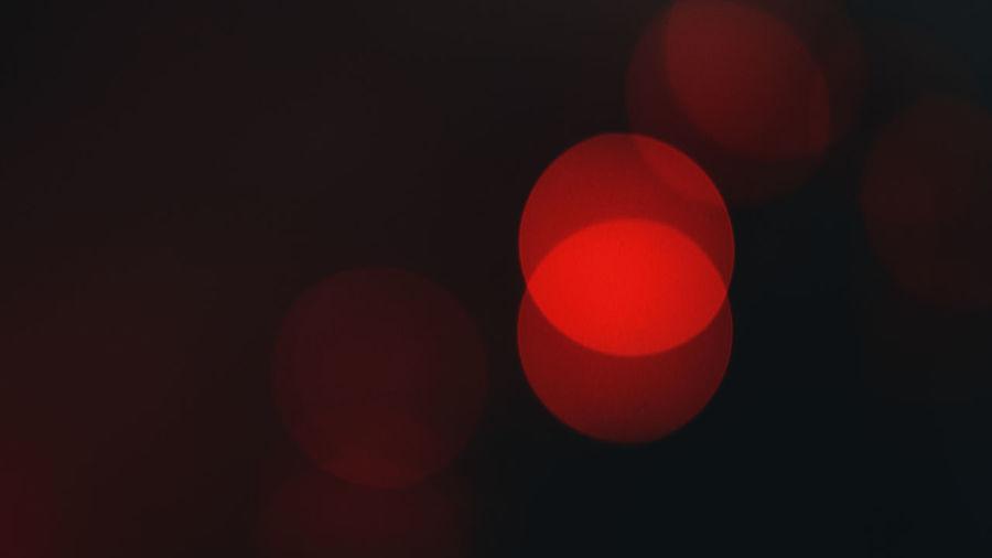 Defocused image of lights against black background