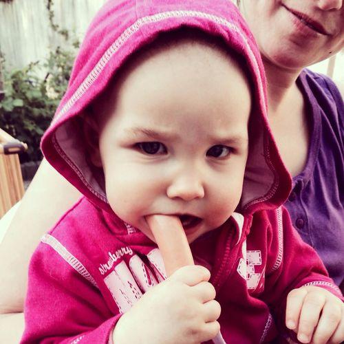 Little Girl Eating Sausage