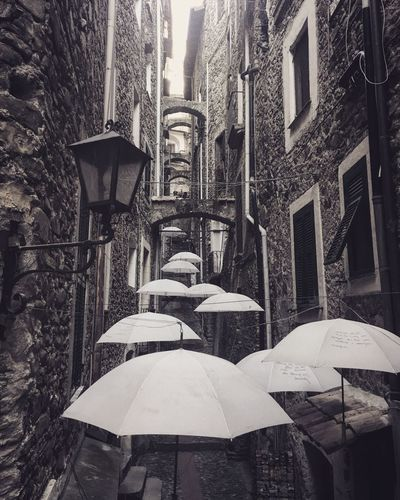 Fly with me Work Of Art Arts Culture And Entertainment Art Perspective Imperia Italy Dolceacqua Sun Decoration Village Stone White Umbrella Umbrella Ideas Design Built Structure Building Exterior Architecture Building City Day No People Low Angle View Outdoors