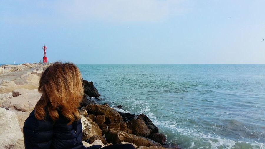 Woman against sea at beach