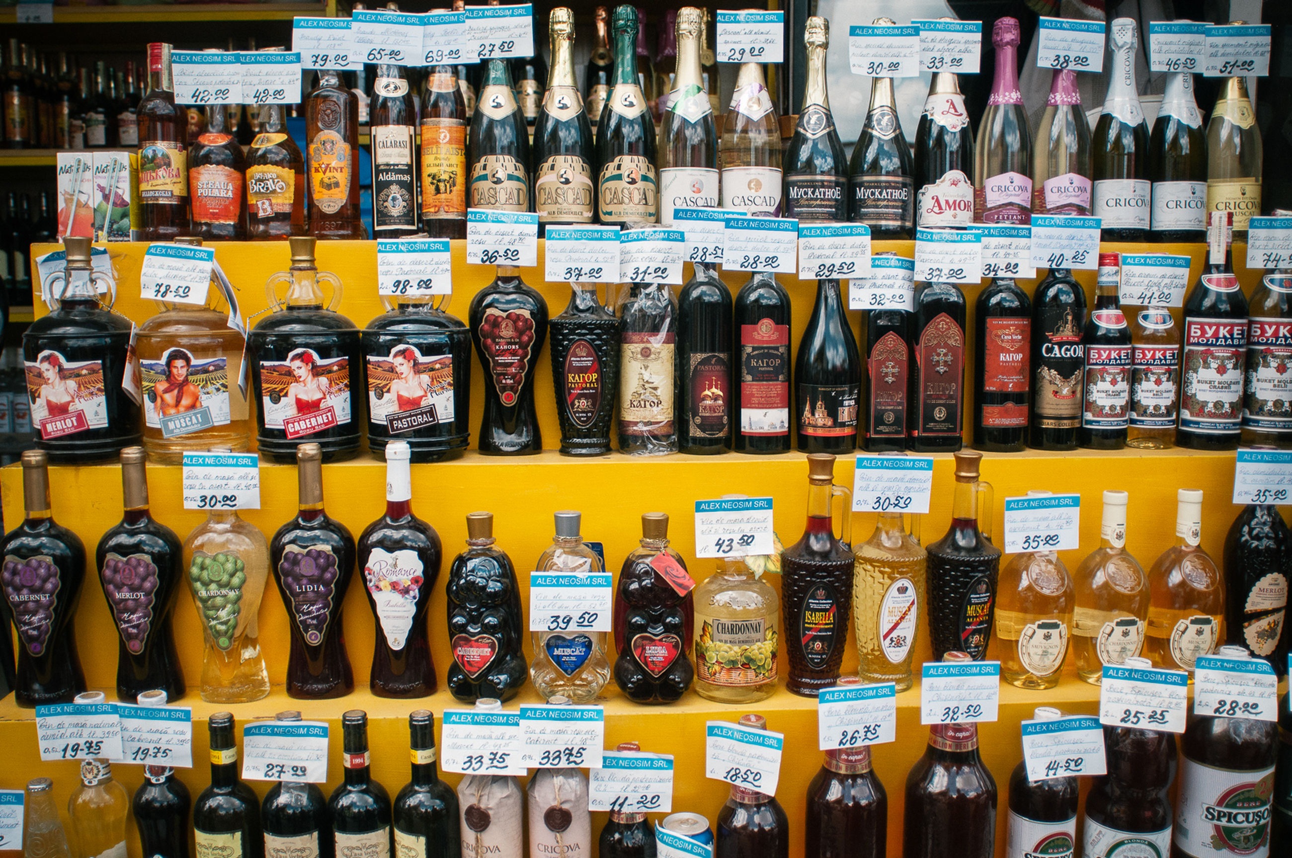 for sale, large group of objects, choice, retail, variation, abundance, indoors, text, shelf, bottle, no people, arrangement, store, full frame, market, food, price tag, day, supermarket