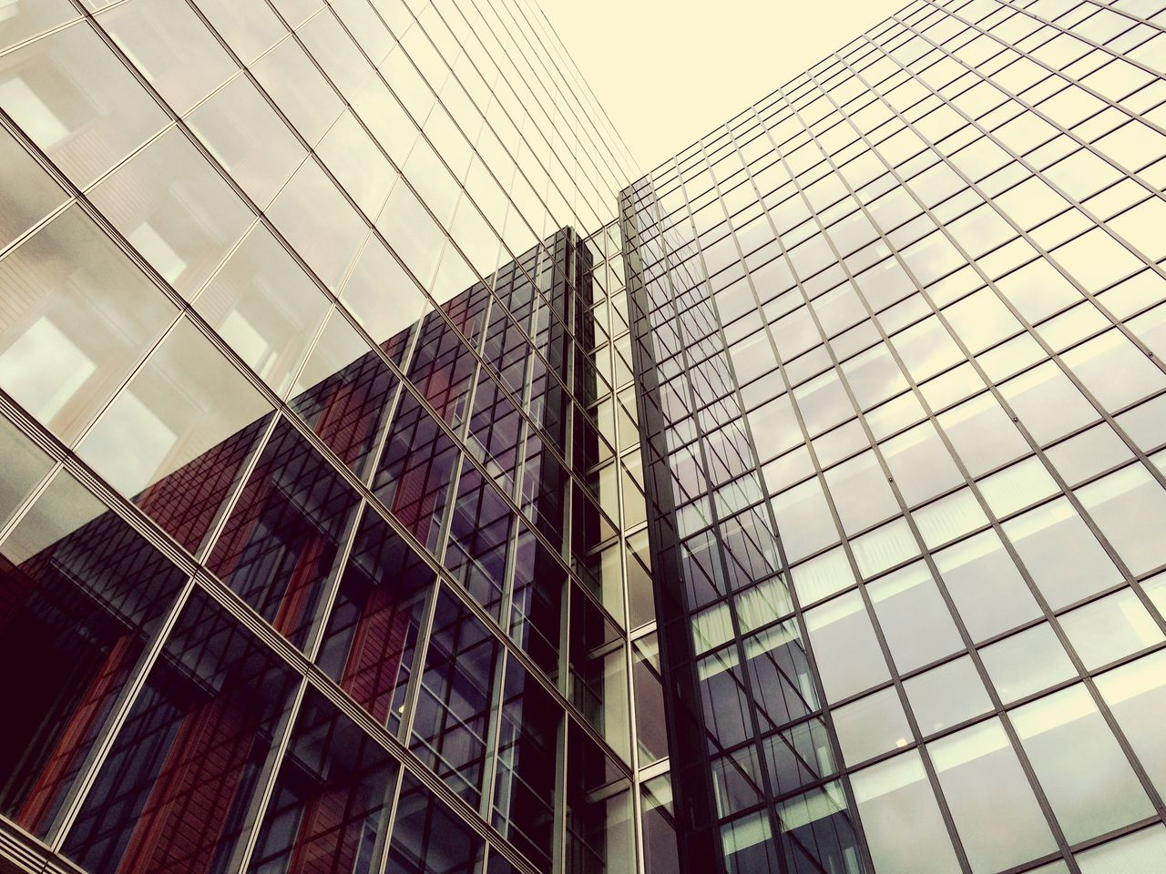 Low Angle View Of Modern Building With Reflection
